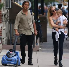 Quality time together: On Monday, Candice Swanepoel, 28,enjoyed a family day out with one-year-old Anacã and fiance Hermann Nicoli, 35