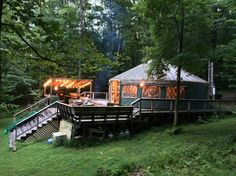 Yurt in Accord, United States. If privacy is your thing then this is for you. This property boasts a private river with a waterfall and swimming hole. Outdoor kitchen on a huge deck, wood fired hot tub, acres of private forest, hot and cold running water, outdoor shower and mor...