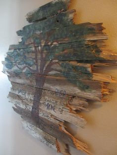 Broken fence beams stacked together to make a palette. Paint a tree and a verse and boom!