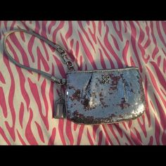 Sequence silver coach wristlet Used only once. Perfect condition. Coach Bags