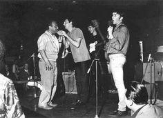 Paul McCartney, George Harrison and John Lennon.