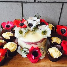 Red velvet and cream cheese cake with gluten free red velvet cupcakes.  #glutenfree #redvelvetcake #babyshower #nakedcake #poppies