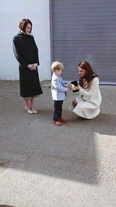 """George hands The Duchess a wooden train for Prince George #DuchessAtDownton @EalingStudios"""