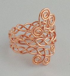 filigree ring How to make the connection of the 2 braided parts?