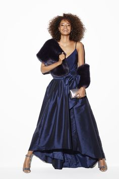 Go for Bond-style glamour this party season with Coast's rich navy satin skirt. With a shape-cinching bow tie waist, this ball gown style is unapologetically flattering and the perfect partner to sparkling silver shoes. Team with a tonal camisole and encase yourself in a fluffy wrap to complete the look. Boohoo Sophie body   Coast Modena skirt, Coast Luella wrap, Steve Madden pumps, Menbur Tosca clutch, Lulu Frost Brigitte earring.