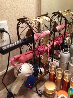 Wow...good idea... Use a small wine rack as a holder for your blow dryer, straightener ...
