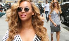 Beyonce flaunts her curves in a striped wrap dress in New York