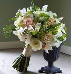 This bouquet, but center flowers a bit more apricotty...