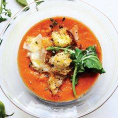 Tomato Soup With Arugula, Croutons, And Pecorino   Don't pass over slightly bruised or extra-ripe tomatoes; they're often the most flavorful and especially good here.