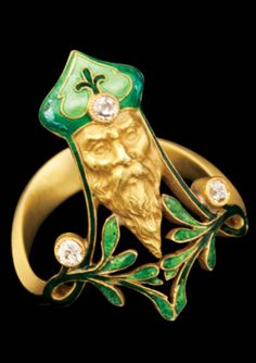 A Symbolist gold, enamel and diamond ring, by René Lalique and Paul Briançon, French, ca. 1890. Designed as Father Christmas.