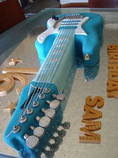 a bunch of cool guitar cakes @Amanda Snelson Mayorga