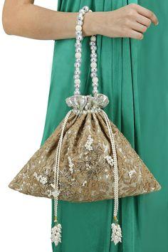 Brown embellished chikankari potli bag BY 5 ELEMENTS. Shop now at…