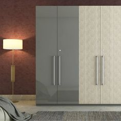 A dual tone swing door wardrobe for segregating your essentials Wardrobe Interior Design, Wardrobe Door Designs, Wardrobe Design Bedroom, Bedroom Bed Design, Bedroom Furniture Design, Modern Bedroom Design, Wardrobe Laminate Design, Alcove Wardrobe, Wooden Wardrobe