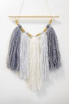 Handmade tassel wall hanging called Neutral touch for your sweet home or work studio! Made from ivory and light, middle dark grey wool and wooden beads. Size: 6.3 x 11.8 / 16 x 30 cm Width of dowel: 7.9 / 20 cm WORLDWIDE shipping - READY to ship! MORE wall hangings in my shop: