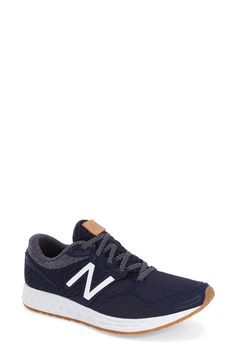 These trendy yet sporty New Balance running shoes would look too cute with distressed boyfriend jeans and a tee while running errands.