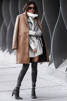 Erica Hoida is totally glam in this gorgeous winter style, consisting of thigh high suede boots, a matching suede jacket with belt detailing, and a classic camel overcoat. Give this look a try and be sure to achieve immediate sophistication! Coat:...