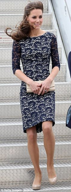 "it was worn for William and Kate's arrival in Canada on the first day of last summer's North American tour. The dress is described as ""stone with navy lace overlay, a bateau neckline, scoop back, and sheer three-quarter sleeves. Designed by Erdem Cecile"