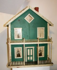 Nice old hand made dollhouse, I don't know the age.  .....Rick Maccione-Dollhouse Builder www.dollhousemansions.com
