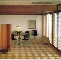 Private home of Poul Kjaerholm with his PK54 table and PK9 chairs