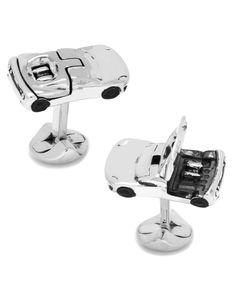 Cufflinks Inc. sports car shaped cuff links. Silver-plated base metal. Stainless steel. Round logo swivel back closure. Imported.