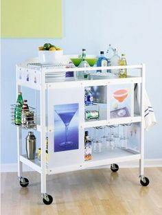 Repurposed Changing Table! This is a drinks cart but I bet I could make ours into extra kitchen storage or a microwave cart.....