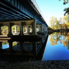 Photograph by Eileen Rench @grandrapidsparks @pure_michigan_ #bridges #reflection #trees #shadows #colorful #contrast #grandrapids #sunshine #art #photography #tbt #line #michigan #kenttrails