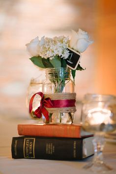 DIY Centerpieces with Vintage Books | Milton Photography | See More: http://heyweddinglady.com/ruby-and-gray-wedding-with-vintage-book-details-from-milton-photography/