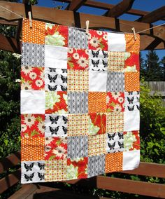 i love the mix of colors and patterns in this quilt.