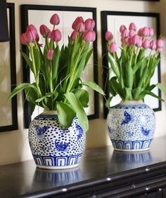 Tulips in matched pair of blue & white oriental pots