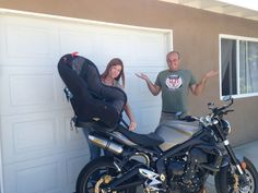Our pregnancy announcement: Got a new part for the motorcycle, but we can't figure out how it works!