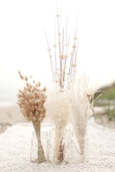 Mason jars filled with soft wheat grass, perfect for a beach event.    Photo:  Amy Rizzuto Photography