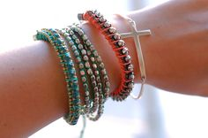 New bracelets with cross and studdsfrom H and Gina Tricot