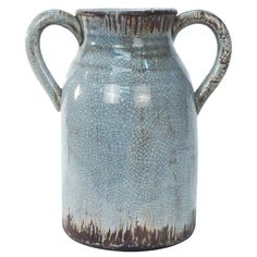 Weathered ceramic vase with side handles.  Product: VaseConstruction Material: CeramicColor: Blu...
