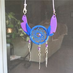 1 1/4 inch center head and ears are made with foam paper! Hand woven, looks awesome hanging from a rear view mirror! To hang up, just open up the little clasp on one of the ears, wrap it around your mirrors handle and hook it again