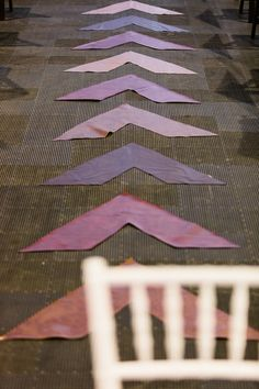 """Your friends have : A rose petal path or monogrammed aisle runner.     We prefer : A bold, modern graphic design, like these ombre arrows """"directing"""" the bride down the aisle.    Image by  Jon Paul Douglass ."""