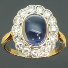 Blue water sapphire diamond engagement ring 1950s vintage jewelry. €3,250.00, via Etsy.