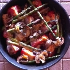 Plum tomatoes, brown mushrooms, asparagus spears, EVO, salt/pepper and lemon broiled with Monterey Jack cheese.  So good!!