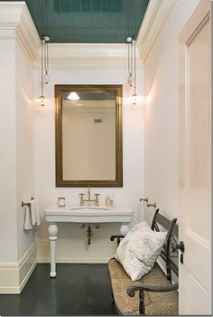 The powder room. The lacquered beadboard on the ceiling looks like a mirror of the floor.