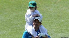 Padraig Harrington with his son on the road to victory at the Par-3 Contest yesterday.
