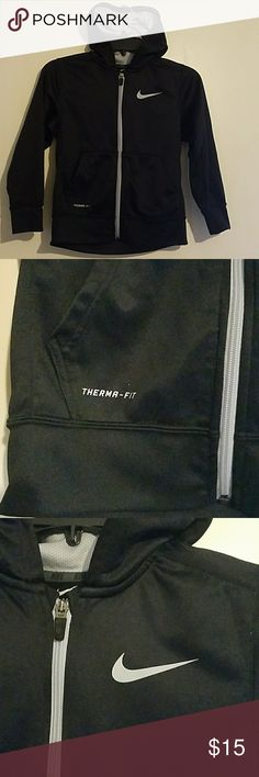 """Nike Boys Black Therma Fit Jacket Size Small Excellent condition  (no flaws). It is black and has silver / light grey nike sign and zipper. Long sleeves. Style is therma-fit. Hooded. Armpit to Armpit measures 16.5"""", the Lenth is 20"""" and the Arm Length is 18"""". Nike Shirts & Tops Sweatshirts & Hoodies"""