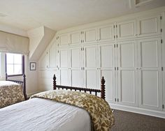 Wall of built-in cabinetry in bedroom.