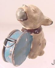 VINTAGE METAL SEWING TAPE MEASURE DOG WITH BALL IN MOUTH DRUM ETC., GERMANY