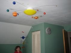 Planets - Solar System Ceiling Light Chandelier Fixture: My husband is an aerospace engineer (a rocket scientist) so he was excited about this solar system for the kids room and to share his love of space with
