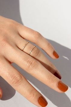 Reversible X-Ring can be worn with the X in front or flipped around as a double band. Available in 14k Yellow Gold Fill, 14k Rose Gold Fill + Sterling Silver. Handmade in Oakland, CA.