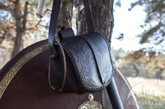 Handmade genuine leather bag with Viking's style embossing and brass decorations. Bag has removable shoulder strap.