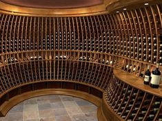 A super curved and stylish wine cellar to fit an awkward space. Wine Shelves, Wine Storage, Tasting Room, Wine Tasting, Caves, Wine Cellar Basement, Wine Furniture, Home Wine Cellars, Wine Cellar Design