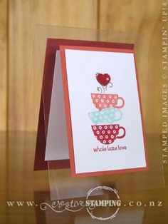 """This Window Sheet/acetate card that uses the sweet """"whole latte love"""" stamp from the Patterned Occasions Sale-A-Bration stamp set.  To get the stacked-cups-effect, I used the Stampin' Write Markers (so I only have ink where I want it) and masking."""