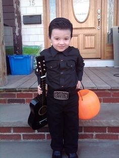 I do not have lil' ones to dress up for Halloween anymore, but I had to share this because it's wicked cute!! Little Johnny Cash!! <3