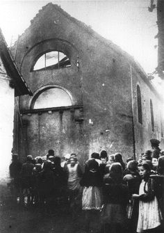 German children watch as a synagogue in Kuppenheim, Baden Germany, burns during Kristallnacht, the Night of Broken Glass. November 10, 1938. Photo credit: Hauptstaatsarchiv Stuttgart, courtesy of USHMM Photo Archives.