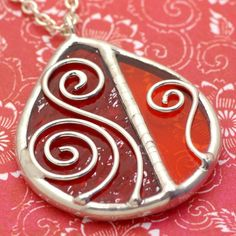 Red Spirals Stained Glass Pendant. In my shop for $24, made to order.